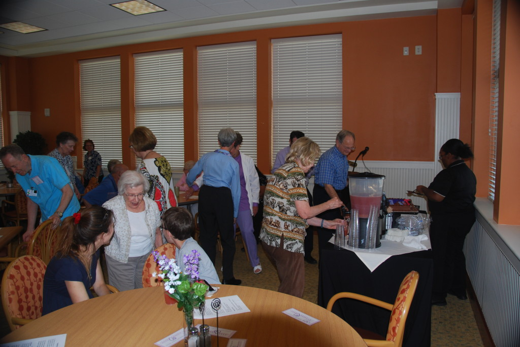 Dancing, singing, enjoying refreshments, and spending time together to celebrate.  Priceless!