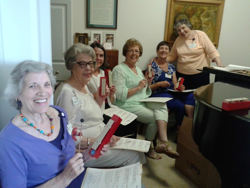 Music group holding chimes